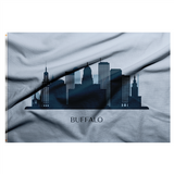 "SKY BLUE FLAG WITH A CITYSCAPE IN THE CENTER AND THE WORD ""BUFFALO"" UNDERNEATH"