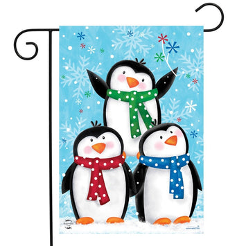 blue flag with snowflake background and 3 baby penguins on the front