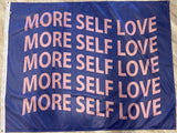 "PURPLE BACKGROUND FLAG WITH PINK TEXT THAT SAYS ""MORE SELF LOVE"" MULTIPLE TIMES"