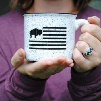 WHITE CUP WITH BLACK SPECKLES AND BUFFALO AMERICANA FLAG