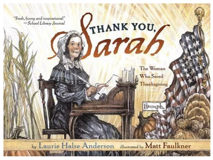 BOOK COVER WITH A PILGRIM WOMAN SITTING AT A DESK WRITING; THERE'S A US FLAG AND A TURKEY IN THE BACKGROUND