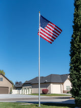 Telescopic pole made in the USA. Features interlocking sleeves and ability to hang two flags using provided clips. Includes a USA made nylon flag.