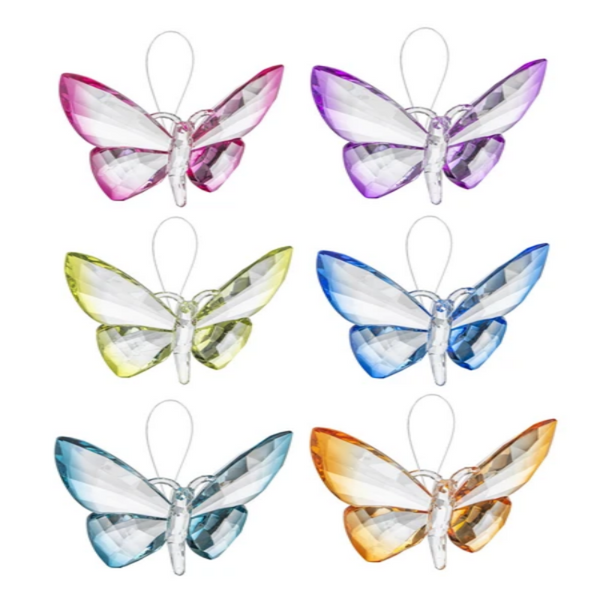 multiple acrylic butterflies in various color options attached to a string