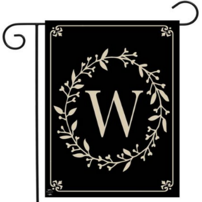 black monogram flag with leaf ring around the letter W