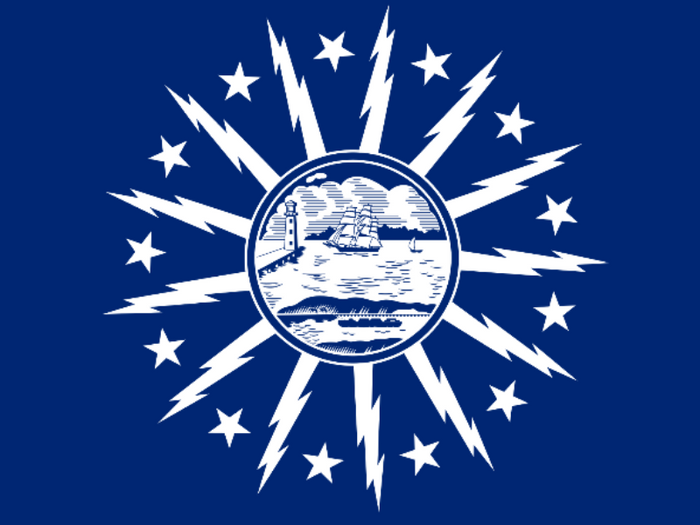 BLUE DECAL WITH A SHORE AND LIGHTHOUSE IN THE CENTER WITH LIGHTNING BOLTS AROUND THE CENTER