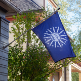 BLUE FLAG WITH A SHORE AND LIGHTHOUSE IN THE CENTER WITH LIGHTNING BOLTS AROUND THE CENTER OFF THE HOUSE