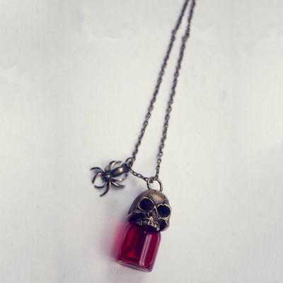 Free -  Skull Blood Bottle Necklace