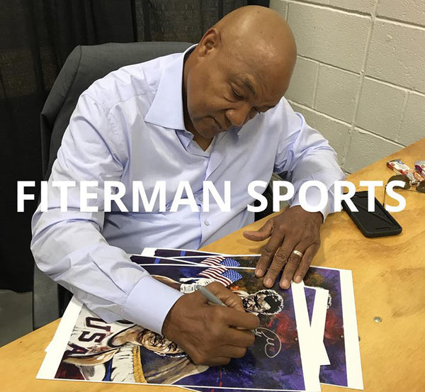 George Foreman signing fine art print by Robert Hurst