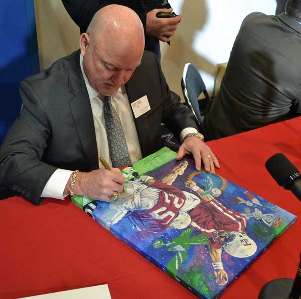 Tony Franklin signing painting by Robert Hurst