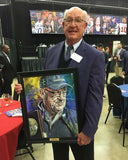 Pete Fredenburg with his Texas Sports Hall of Fame artwork by Robert Hurst