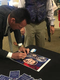 Gary Kubiak signing fine art print by Robert Hurst at Texas Sports Hall of Fame Induction 2018