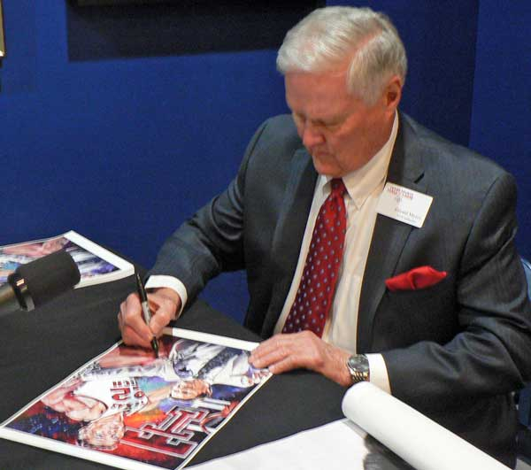 Gerald Myers signing fine art print by Robert Hurst