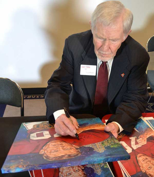 Loyd Phillips signing painting by Robert Hurst