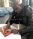 Andre Dawson signing his CBHOF fine art print by artist Robert Hurst