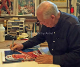 Augie Garrido - Texas autographed fine art print being signed by Garrido
