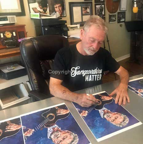 Larry Gatlin signing limited edition fine art print by artist Robert Hurst