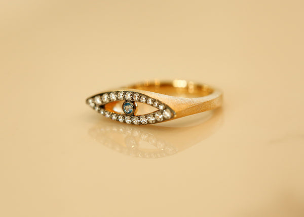 The Protection from Evil Eye Vermeil Gold Ring with Blue Topaz Center