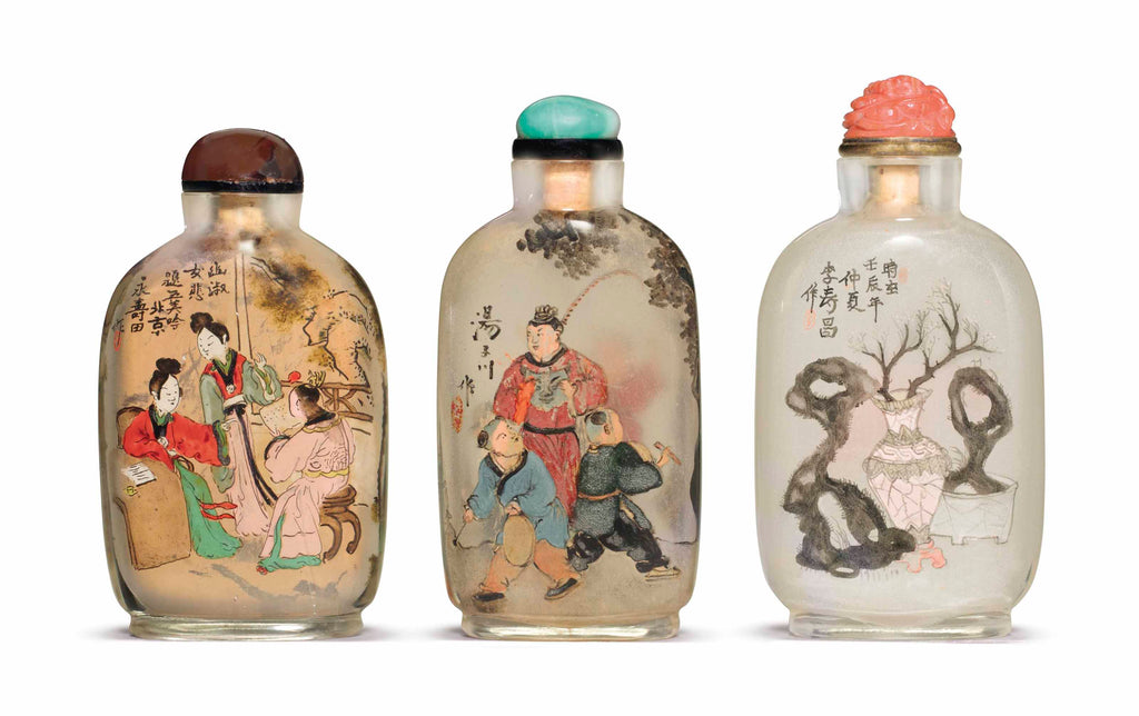 Three reverse-painted glass snuff bottles