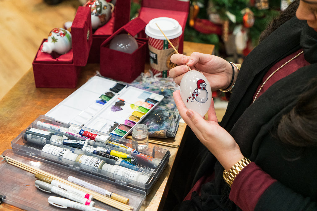 Trieste Cordova using the reverse painted glass technique on ornaments at Montana Gift Corral