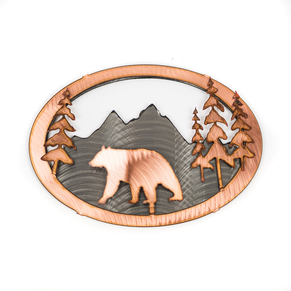 No home is complete without showing some Rocky Mountain love! This beautifully crafted 3D Copper Bear Wall Art by H&K Studios shows a mountain landscape with a bear and trees in the foreground.