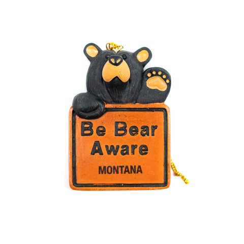 If you are an avid camper, hiker, or nature-walker you know this phrase all too well. The Bearfoots Bear Aware Montana Ornament by Big Sky Carvers reminds you to be aware of bears when you are in the wilderness.