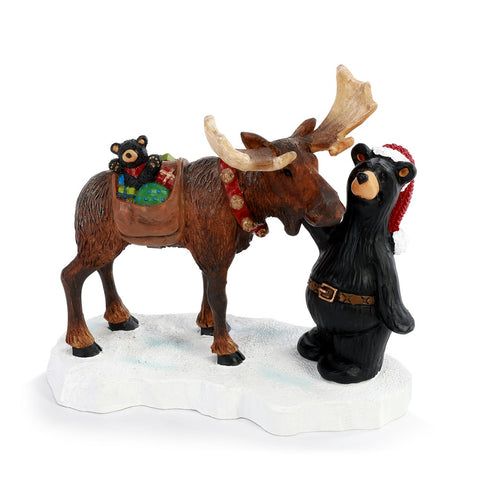 Everyone wants to be Santa Claus! This Bearfoots bear and his moose friend are delivering gifts to the children for Christmas! The Bearfoots Where Next, Santa? Figurine by Big Sky Carvers will warm your heart and makes a great gift for anyone this Christmas!