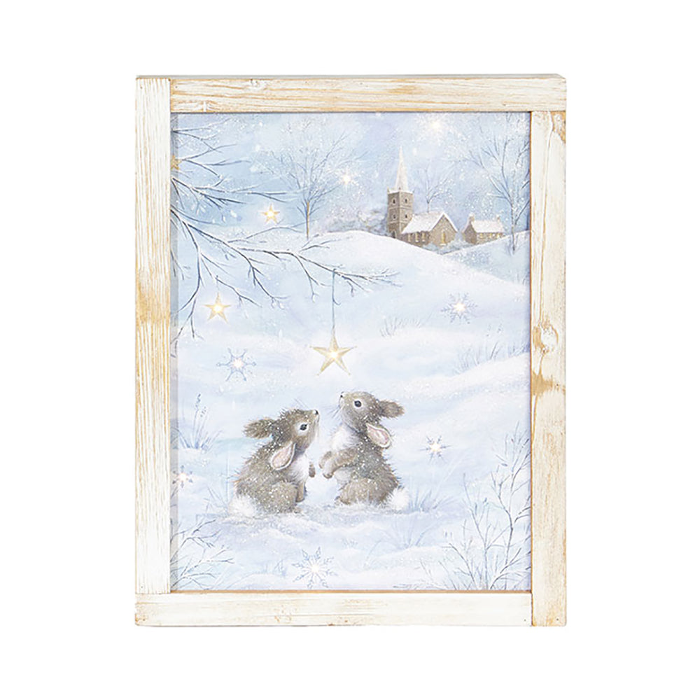 The Bunny with Church Lighted Framed Print by RAZ Imports brings this glowing scene to life with soft blues and twinkling lights!