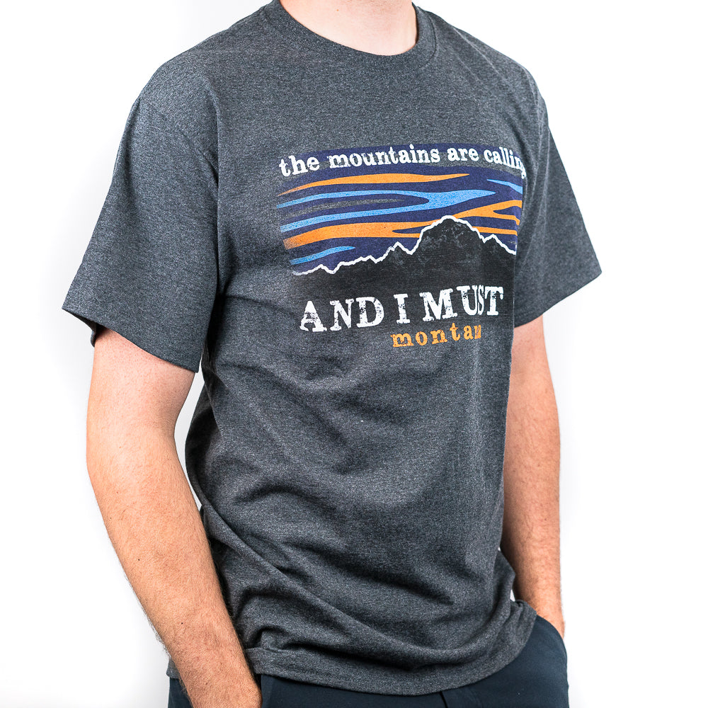 The mountains call to all of us here in Montana. The Dark Grey Mountains Calling Montana T-Shirt by Graphic Imprints is a great way to let everyone know that you have heard the mountains calling your name!