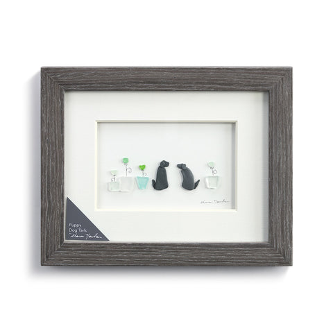 The Sharon Nowlan Puppy Dogs Tails Wall Art by Demdaco gives you the beautiful image of two dogs sitting next to some potted plants!
