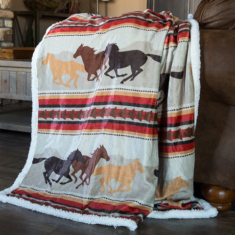 Wrangler Running Horses Sherpa Throw Blanket by Carstens at Montana Gift Corral. Southwestern Motif Fleece Throw Blanket with galloping horse patterns