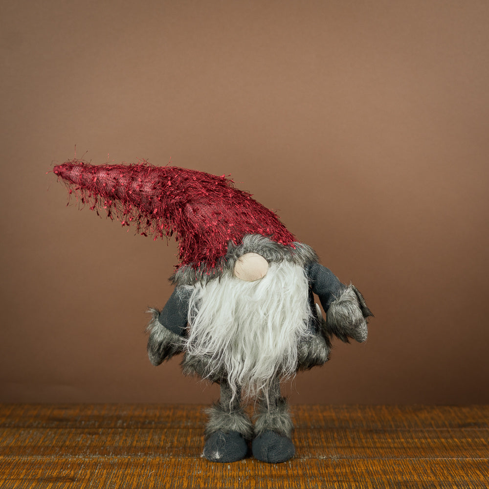 The Fuzzy Hat Gnome by Oak Street Wholesale would love to go to a warm and cozy home with you.