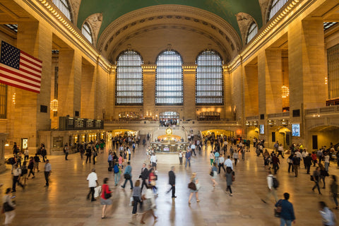 People Commuting at Grand Central Station in NYC learn How to Find Time To meditate on the go with Adelie Skincare Blog