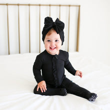 Posh Peanut Footie Ruffled Zippered One Piece - Black Ribbed
