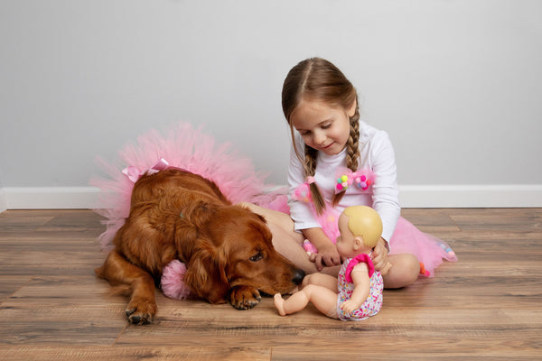Dog and kid playing with Tutus, tutu joli