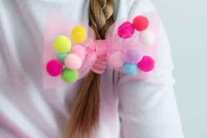 pink tulle bow hair tie with pom pom balls by tutu joli