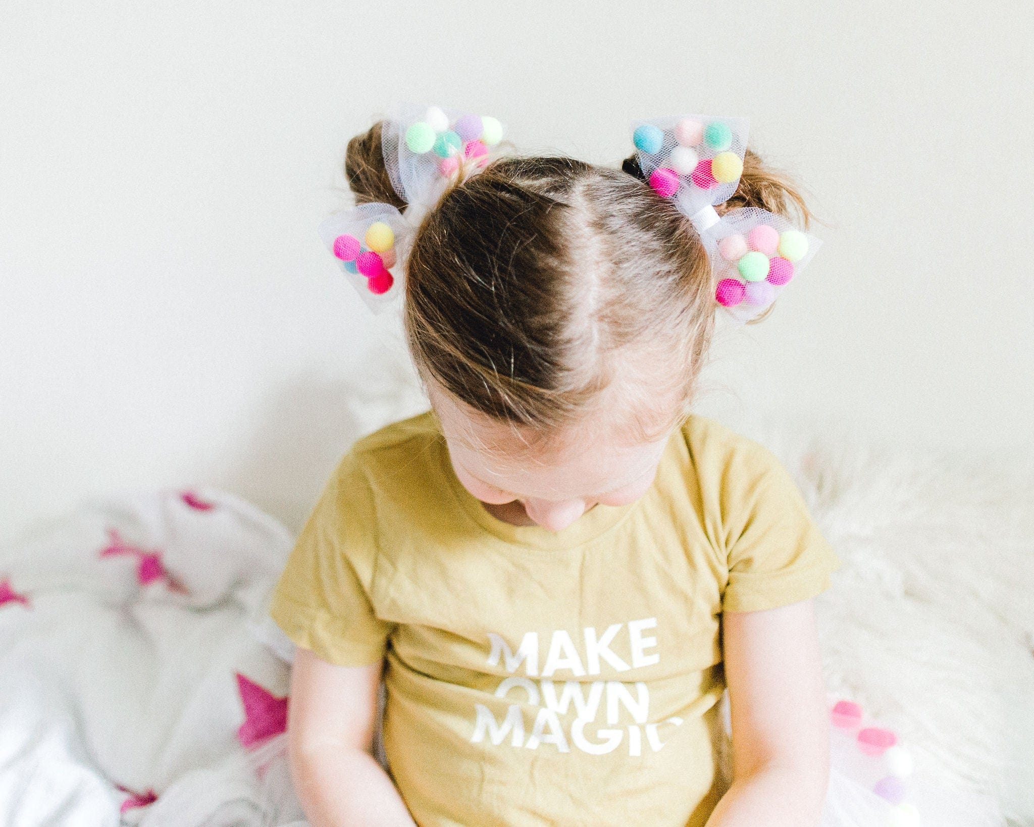 bow hair tie with pom poms. ponytail holder for kids by tutu joli