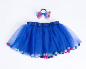 pom pom hair tie bow for children, designer hair ties, designer kids accessories, tutu joli blue pom pom tutu skirt, pom pom tutu, royal blue tutu skirt for toddlers, blue pom pom hair bow, pom pom bow ponytail holder in navy blue, pom pom hair accessories, birthday tutu blue, rainbow pom pom balls tutu, tootoo, pompoms, royal blue tutu skirt, navy blue tutu with poms, pompoms, blue tootoo for kids, children's fashion 2020, kids ballet tutu skirt in blue, baby ballet tutu skirt in blue