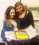 Traci Braxton and daughter-in-law Olivia Harron holding the Alli.C Bee Hive baby blanket, and beanie hat. At Olivia's baby shower that aired on Braxton Family Values.