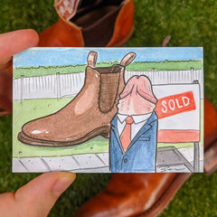 Drawing of penis dressed in a suit selling real estate