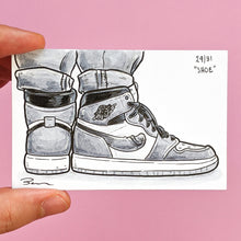 "This original art by Brendan Pearce is called ""Shoe"" and it's the day 29 drawing for Knobtober. It shows a pair of high cut shoes under rolled up jeans and there is curved penis design on the shoe."