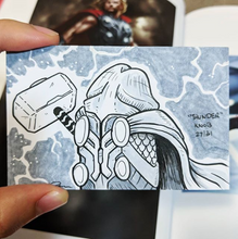 A drawing of Thor the god of thunder holding his hammer but Thor is a penis