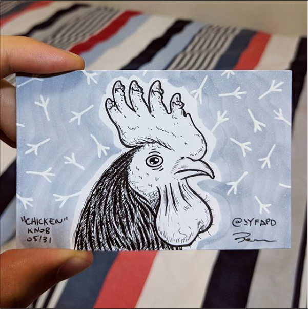 Drawing of a rooster but the comb on the head are penises and the wattle below the chin is a scrotum