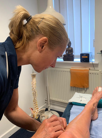 Samantha treating a patient using Acupuncture