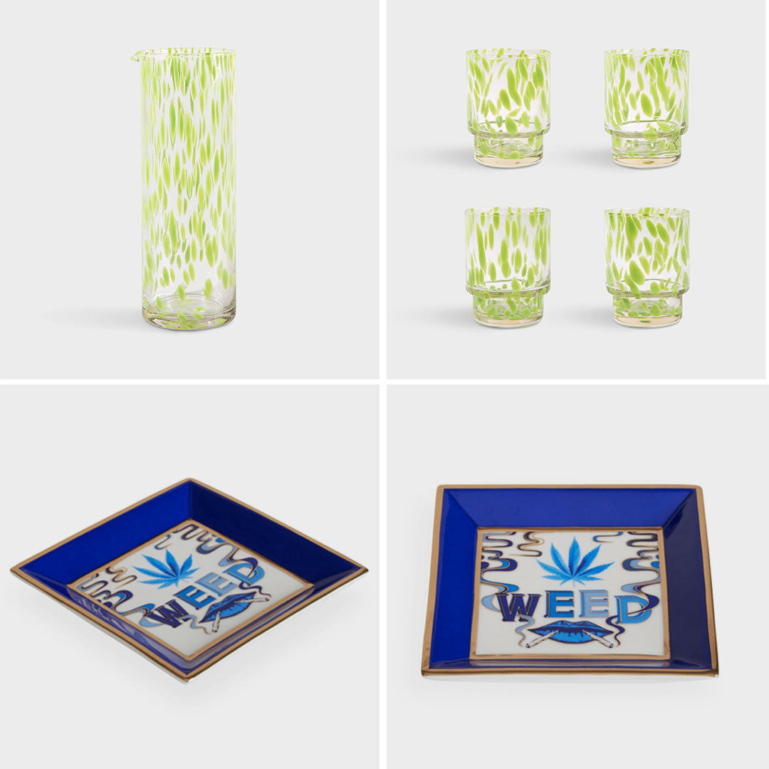 Green tortoise shell design glass straight sided water carafe with matching glasses and Jonathan Adler square blue and white delft design Weed druggist square tray