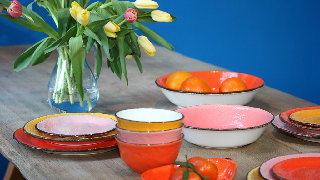 Brightly coloured tableware. Orange, pink and yellow dinner plates, side plates, pasta bowls, soup bowls. Mix and match dinner set. wagreen.co.uk