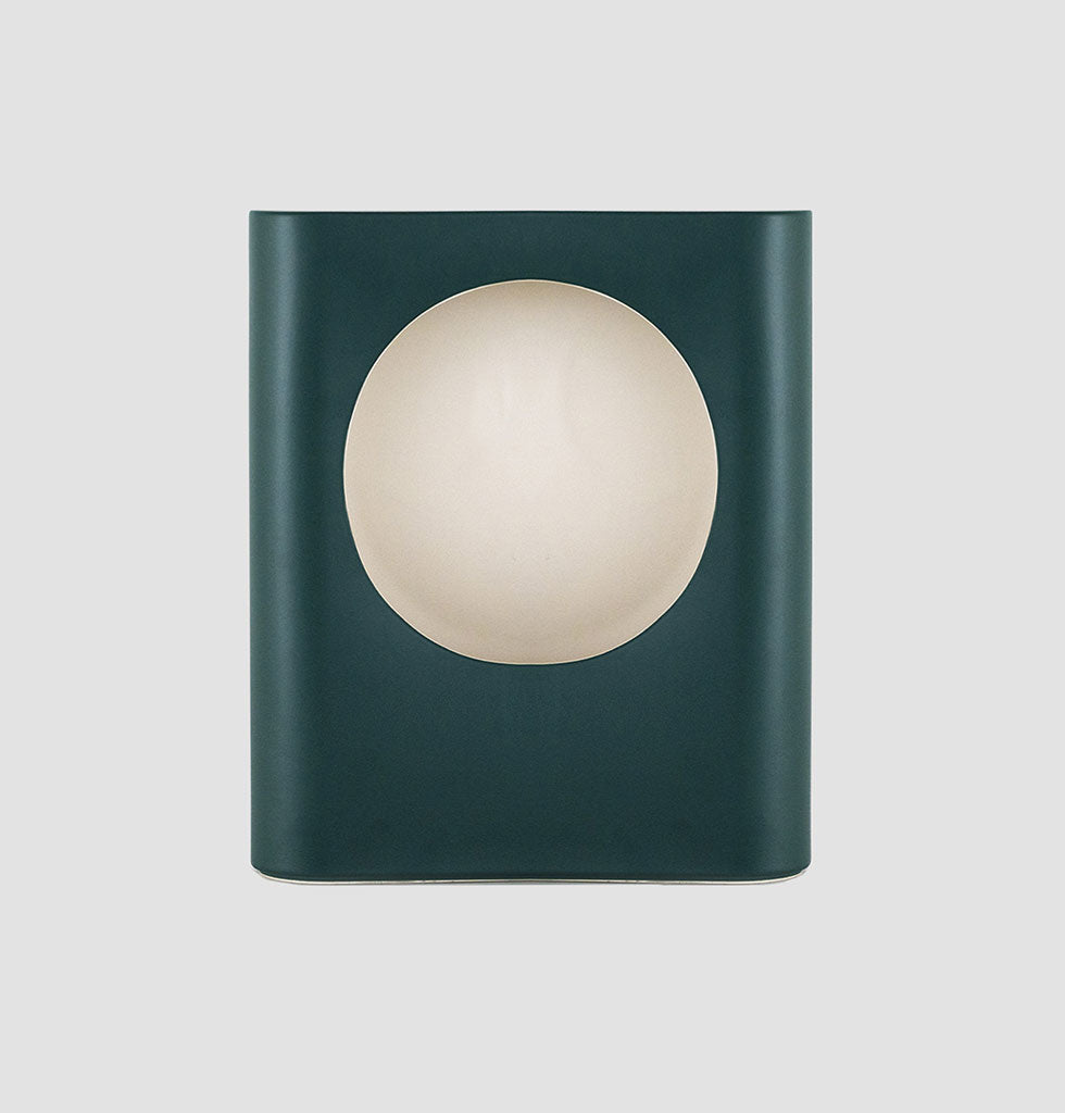 raawii have continued to expand their design portfolio and Signal is their first lighting product by Swiss design duo Panter&Tourron. Inspired by traditional railway signal lanterns these deep green ceramic lights are exquisite with their dimmable bulb. Looking good from every angle the light radiates through the back of the ceramic when lit.  Table lamp in dark green glaze with white inside.