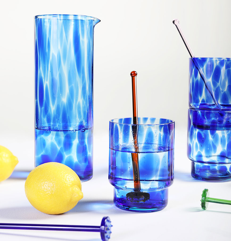 "This bright blue tortoise shell design glass carafe makes water breaks cool.   The blue glass is handblown, giving each carafe it's own unique appearance.   W.A.Green says,  ""Stately and elegant this simple jug design just makes our mouth water."" £33"