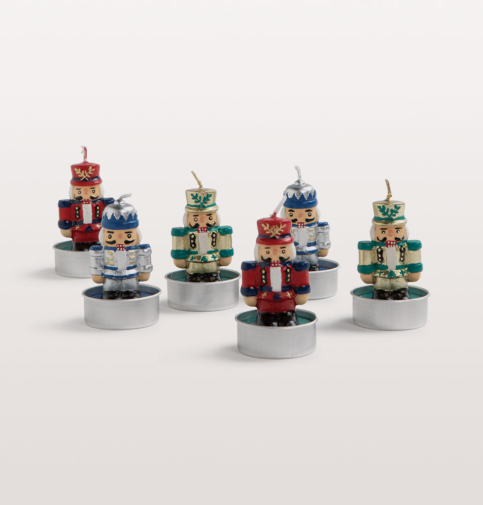 Set of 6 mini nutcracker toy solder table candles. Multicoloured wax candles in the shape of toy soldiers inspired by the Christmas ballet The Nutcracker.