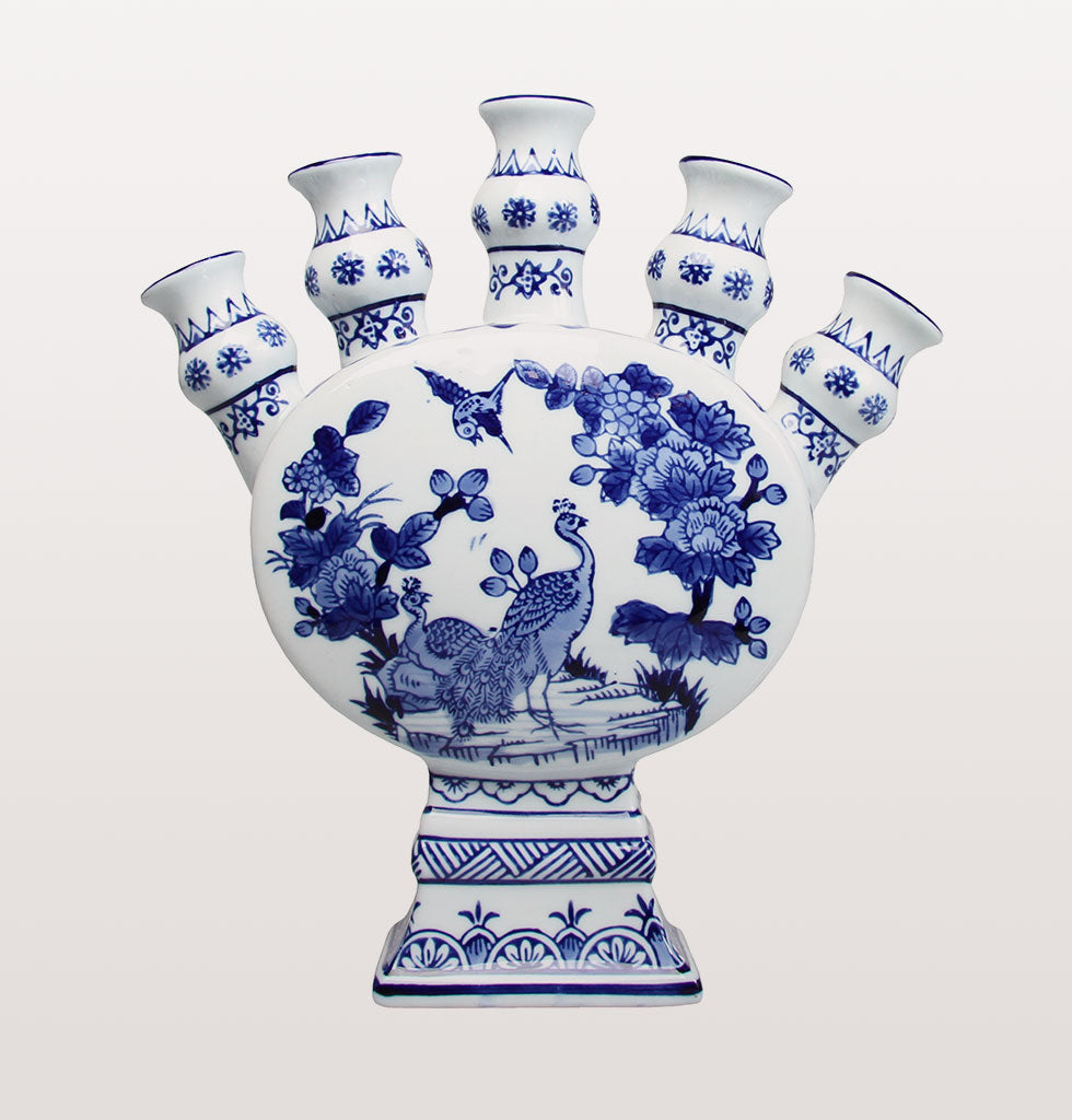 Pretty five stem tulip vase with peacock.  A modern twist on the much famed traditional tulip vase which originated from The Netherlands back in the 1700s when tulips first became fashionable.   5 stem holes form part of this ornate table and centrepiece vase. We're seeing navy coming through interiors as a strong emerging trend and this beautiful multi stemmed flower vase is way ahead of the curve with its pretty peacock design. £64