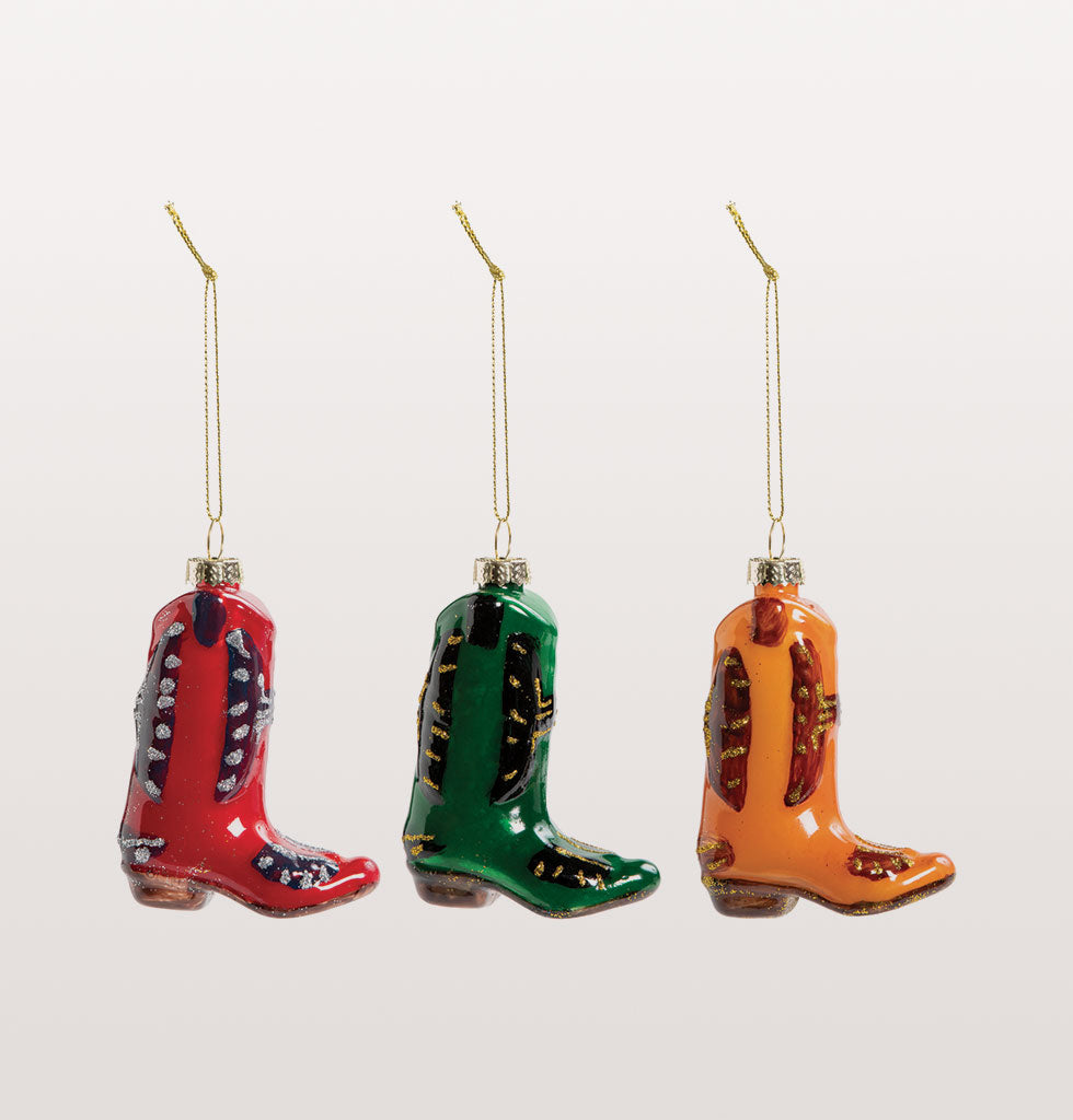 YEEHAW its Christmas! Add some Tex Mex ranch style flavour to your tree with this super cute set of cowboy boot ornaments.  Put your best boot forwards and be strides ahead in these three snazzy Christmas decorations colours of red, yellow and green.    Presented in smart gift box for easy gifting.